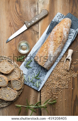 Fresh baguette on wood