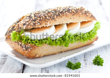 fresh baguette with egg and salad - stock photo