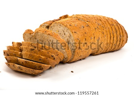 Fresh baked and sliced bread on a white background - stock photo