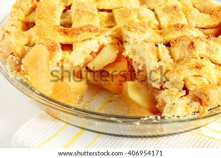 Fresh baked apple pie covered in a lattice crust