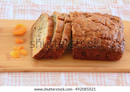 Fresh baked banana bread with sweet apricot pieces in horizontal format