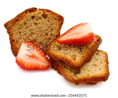 fresh baked banana nut breads, with strawberries  - stock photo