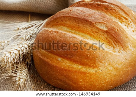 fresh baked bread and ears of wheat