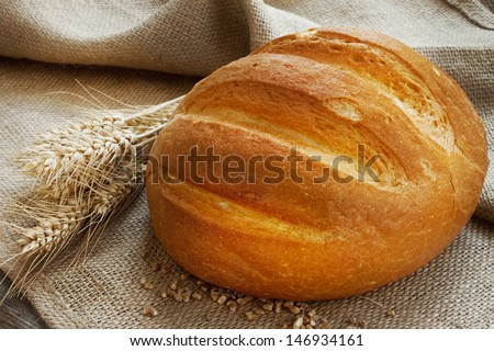 fresh baked bread and ears of wheat - stock photo