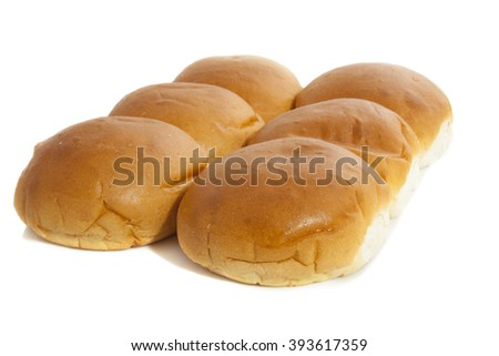 Fresh baked bread buns isolated over white - stock photo