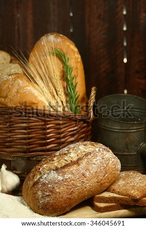 Fresh Baked Bread on Wooden Background - stock photo
