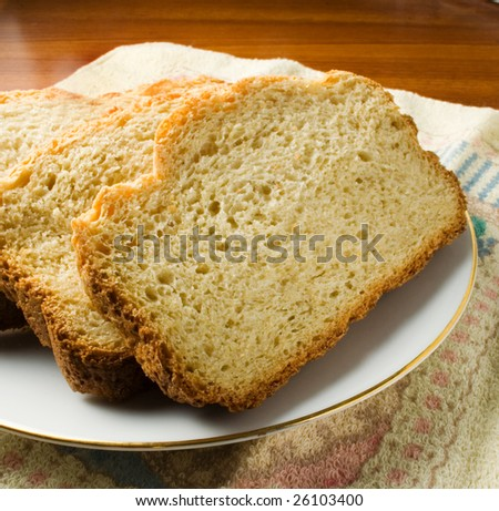 Fresh baked bread sliced ready to eat or serve - stock photo