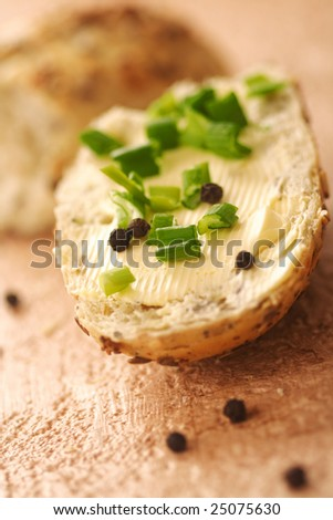 fresh baked bread with butter and chive - stock photo