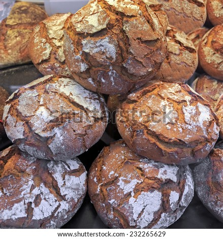 Fresh baked bread with flour, closeup view  - stock photo