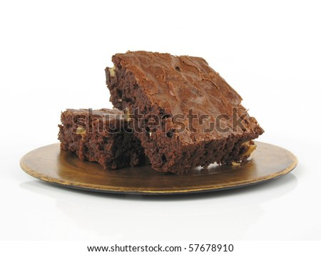 Fresh-baked brownies on a gold-toned plate with white background - stock photo