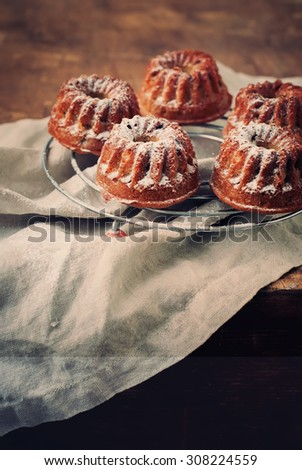 Fresh Baked Cakes with Icing Sugar. Toned vertical image. Country - stock photo