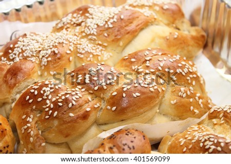 fresh baked challahs on a tray - stock photo