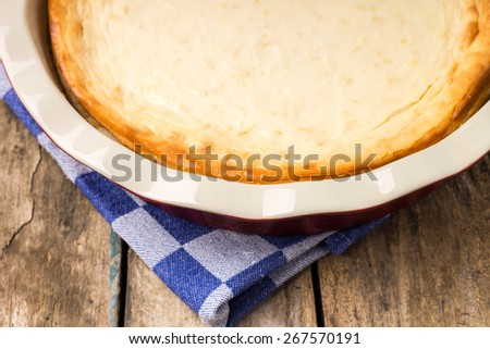 Fresh baked cheesecake on wooden table. Eco food breakfast background - stock photo