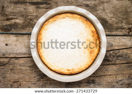 Fresh baked cheesecake on wooden table. Top view image dessert cooking background - stock photo