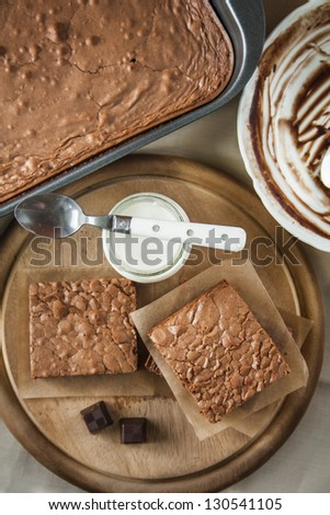 Fresh baked chocolate brownie with yogurt. - stock photo