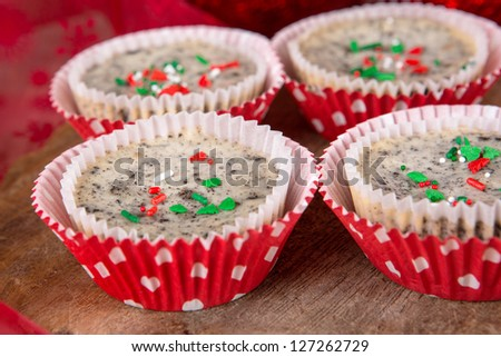 Fresh baked cookies and cream cheesecakes in muffin forms - stock photo