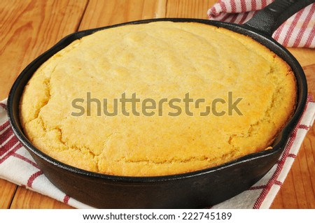 Fresh baked cornbread in a cast iron skillet - stock photo