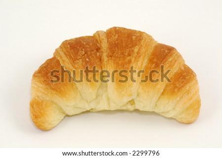 Fresh-baked croissant. Isolated on White. - stock photo