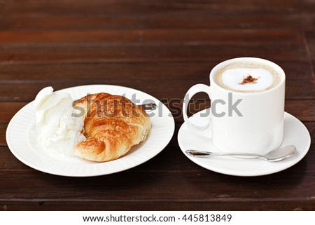 Fresh baked croissants with smug of cappuccino