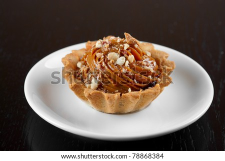 fresh baked cupcake with nuts on a wooden table - stock photo