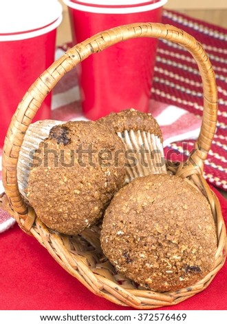Fresh baked Flax muffins in a basket - stock photo