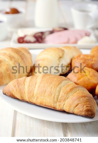Fresh baked French croissants.Selective focus on the front croissant - stock photo