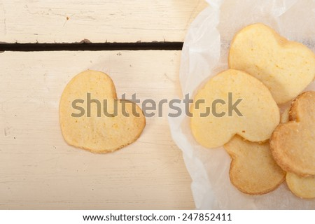 fresh baked heart shaped shortbread valentine day cookies on a paper wrap - stock photo