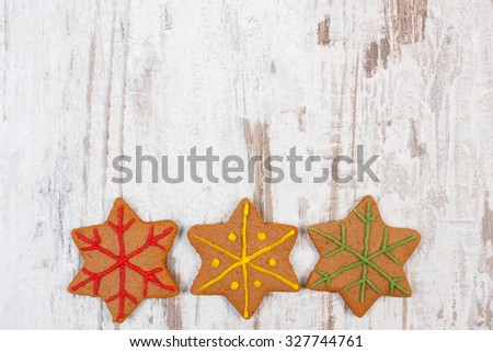 Fresh baked homemade decorated gingerbread and Christmas cookies on old white wooden background and copy space for text, christmas time