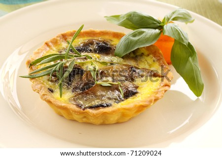 Fresh baked mushroom quiche straight from the oven.
