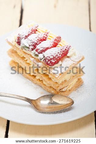 fresh baked napoleon strawberry and cream cake dessert  - stock photo