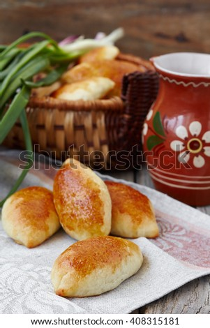 Fresh baked pasties filled with egg and green onion - stock photo