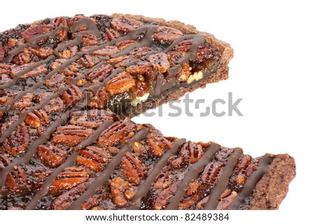 Fresh baked pecan pie isolated on white, a European style dessert made with a chocolate shortbread crust - stock photo