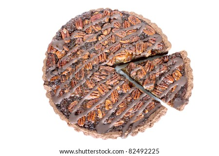 Fresh baked pecan pie isolated on white, a European style dessert made with a chocolate shortbread crust