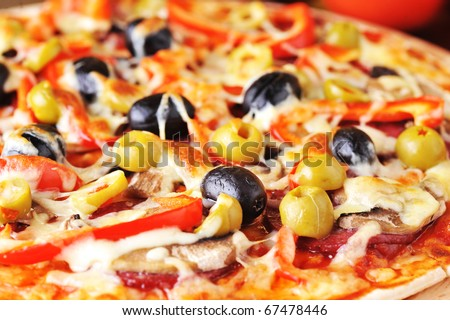 fresh baked pizza with pepperoni olives and peppers - stock photo