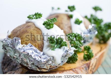 fresh baked potatoe with sour cream - stock photo