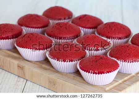 Fresh baked red velvet cupcakes without icing - stock photo