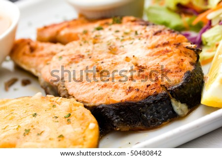 fresh,baked  salmon with hot dip and salad