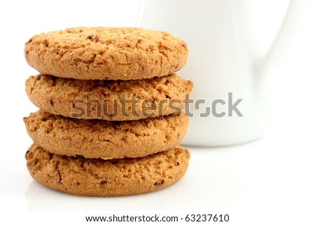 Fresh baked Stack of warm oatmeal cranberry cookies, isolated against white background and white milk jar , shallow DOF - stock photo