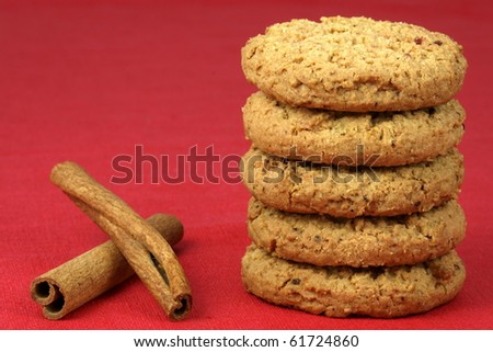 Fresh baked Stack of warm oatmeal cranberry cookies on fine tablecloth made of linen, shallow DOF - stock photo