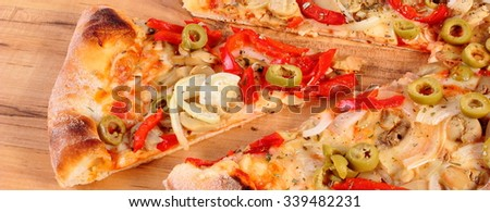 Fresh baked vegetarian pizza ready to eat on wooden table, italian cuisine, concept of fast food