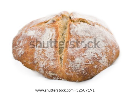 Fresh-baked white wheat bread, isolated on white background.