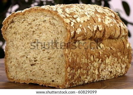 fresh baked  whole grain bread with oats pine nuts and lots of assorted healthy grains
