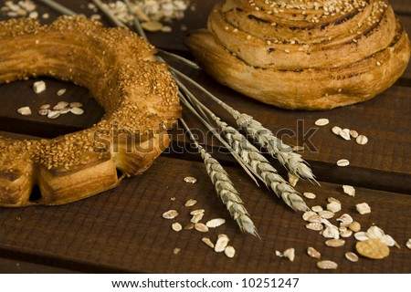Fresh bakery and ears of wheat - stock photo