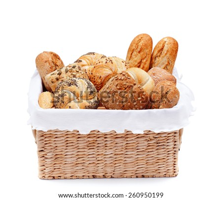 Fresh bakery products in a basket - isolated - stock photo