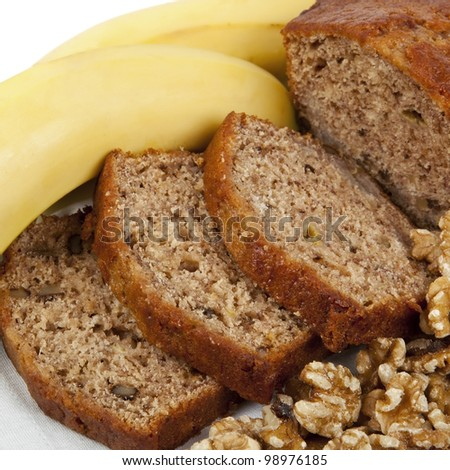 Fresh banana and walnut bread loaf, sliced.  Delicious healthy eating. - stock photo