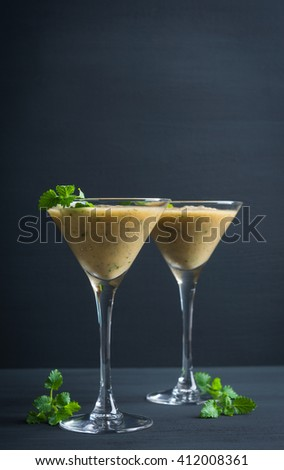 Fresh banana cocktail with mint on the wooden background