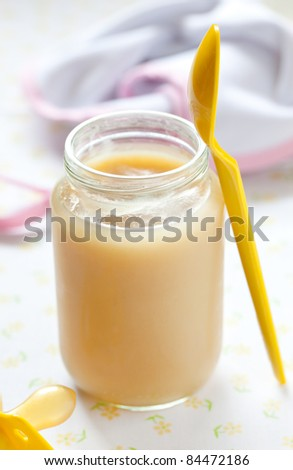 fresh banana puree in a glass with spoon - stock photo