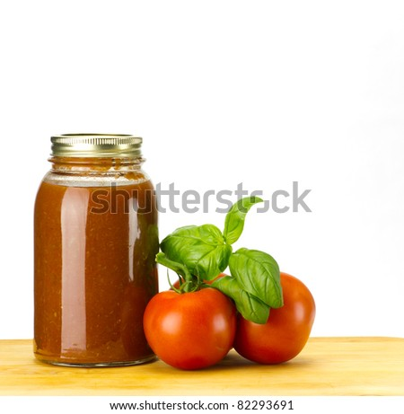 Fresh basil and tomatoes with homemade tomato sauce
