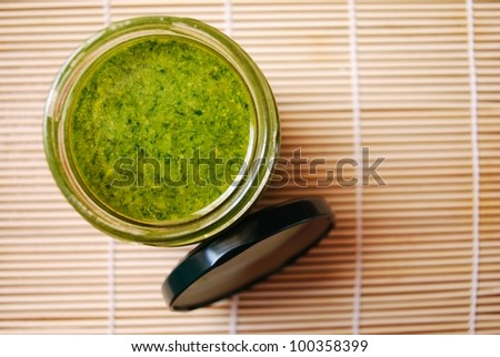 Fresh basil pesto, typical italian green sauce dressing for pasta - stock photo