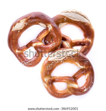 Fresh bavarian pretzels, isolated on white - stock photo